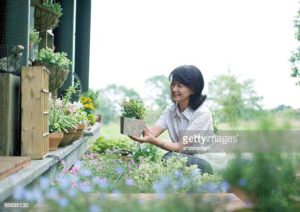 Mature woman taking care of garden
