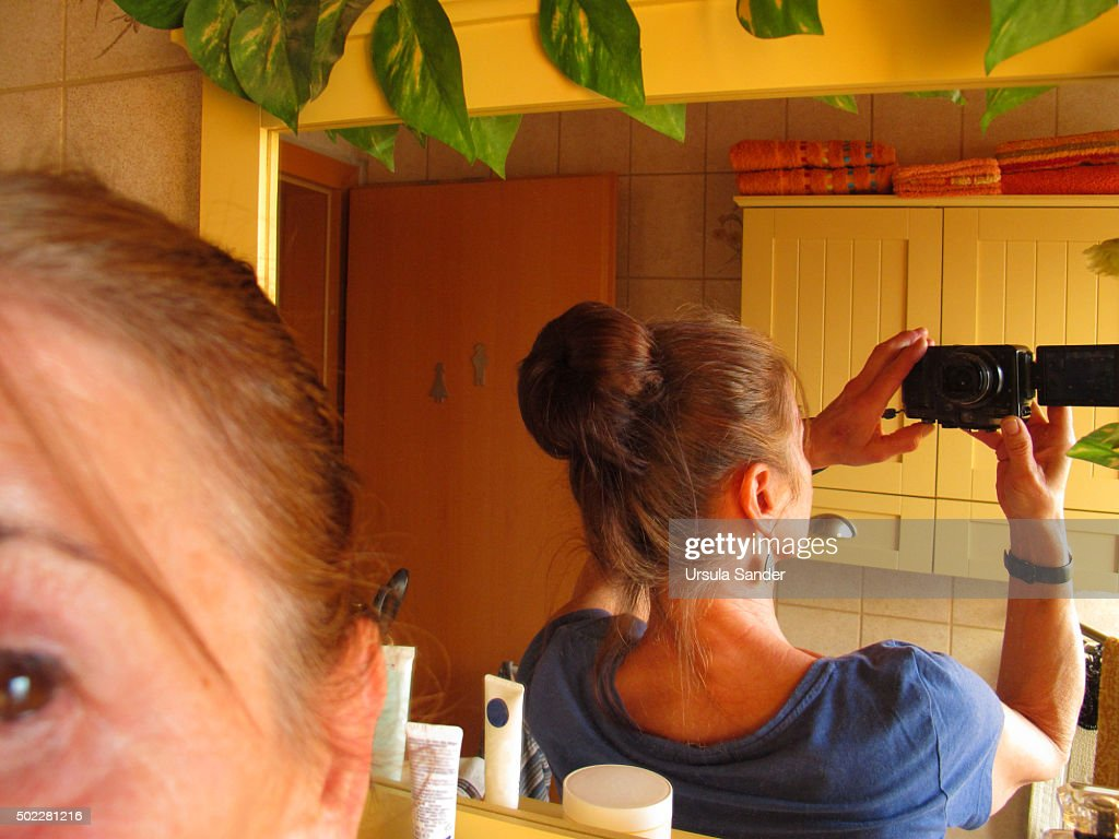Mature Woman Taking Selfie Of Her First Hair Bun Stock Photo - Getty Images-7484