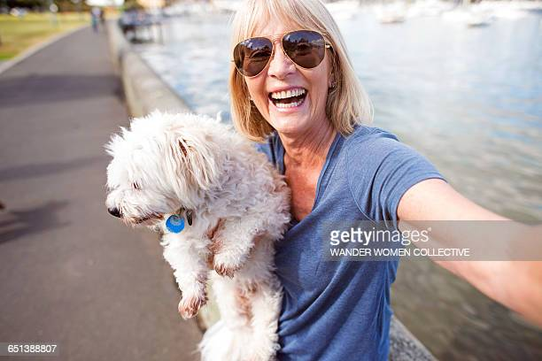 mature woman taking selfie with dog - self portrait stock pictures, royalty-free photos & images