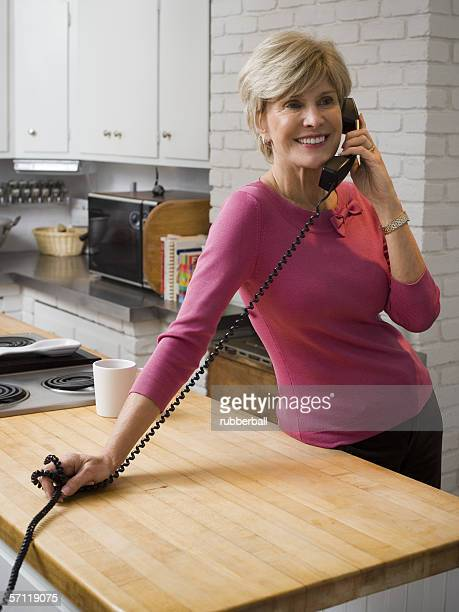 Mature woman talking on the telephone
