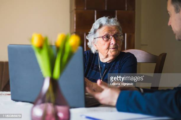 mature woman talking to lawyer - fraud stock pictures, royalty-free photos & images