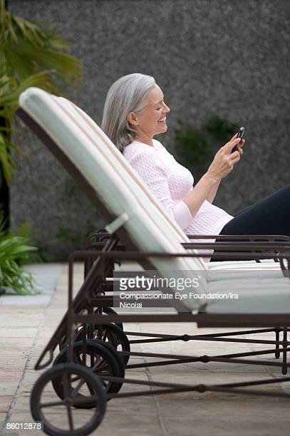 Mature woman texting on a cell phone