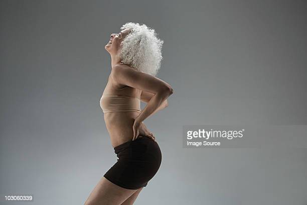 mature woman touching back - beautiful bums stock pictures, royalty-free photos & images