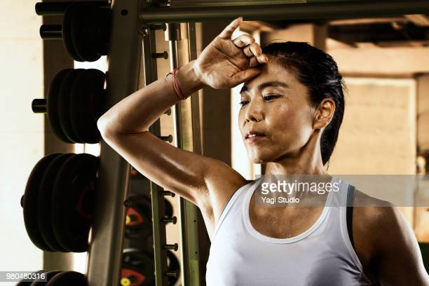 Mature woman training at the training gym