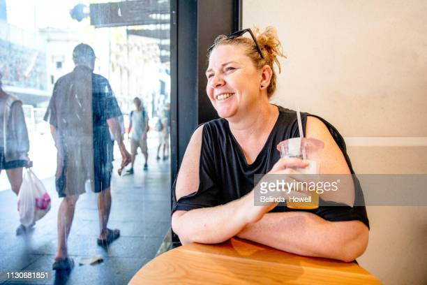 mature woman travelling solo, exploring the city and enjoying time alone in sydney australia - chesty love stock pictures, royalty-free photos & images