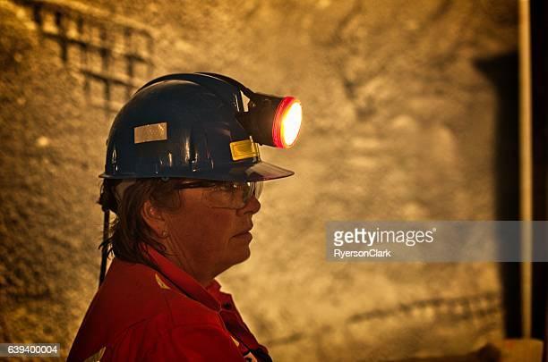Mature woman under ground miner.