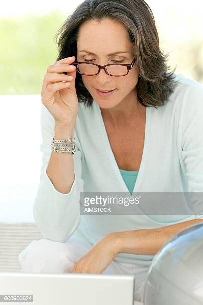 Mature woman using glasses