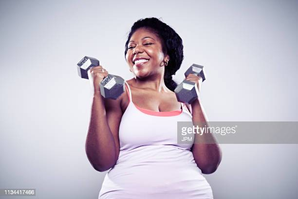 mature woman using hand weights, smiling - hand weight stock pictures, royalty-free photos & images