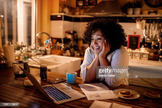 mature woman using her laptop - surfing the net stock pictures, royalty-free photos & images