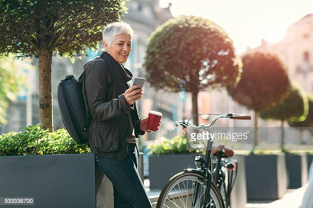 Mature Woman Using Her Smart Phone Outdoors.