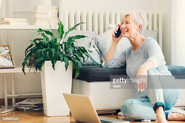 Mature Woman Using Laptop At Home.