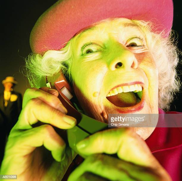 Mature woman using telephone, close-up