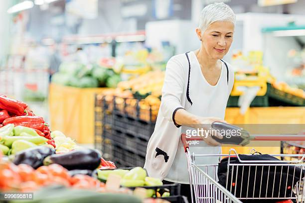 Mature Woman Vegetable Shopping.