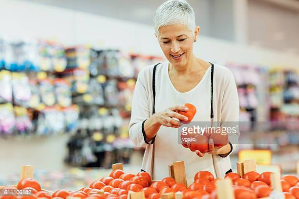 Mature Woman Vegetable Shopping.