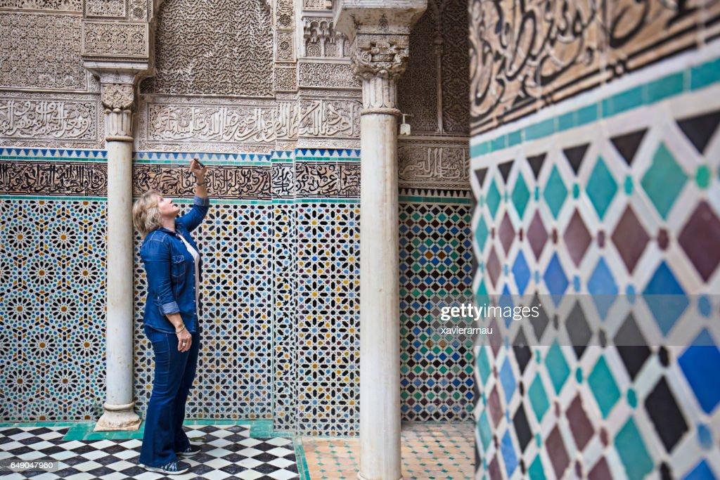 Mature woman visiting Attarine Madrasa in Fez : Stock Photo