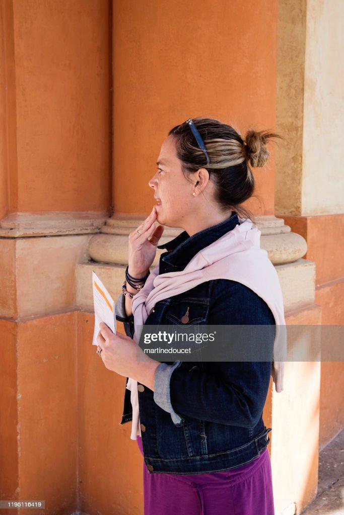Mature woman visiting the Santuary of the Madonna di Santa Luca. : Stock Photo
