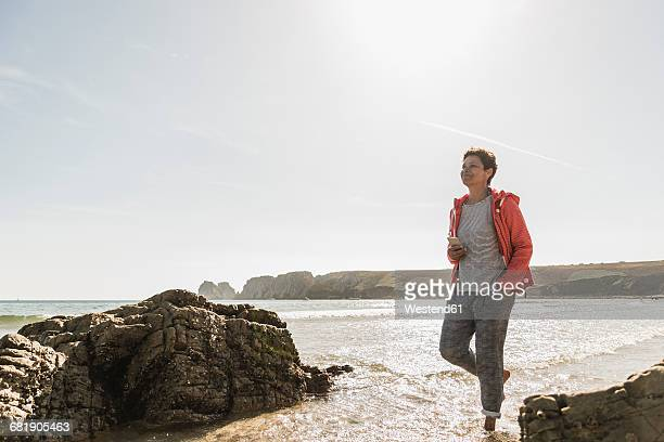 Mature woman wading in the sea