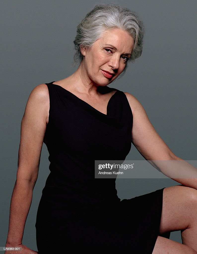 mature woman wearing black dress portrait photo | getty images