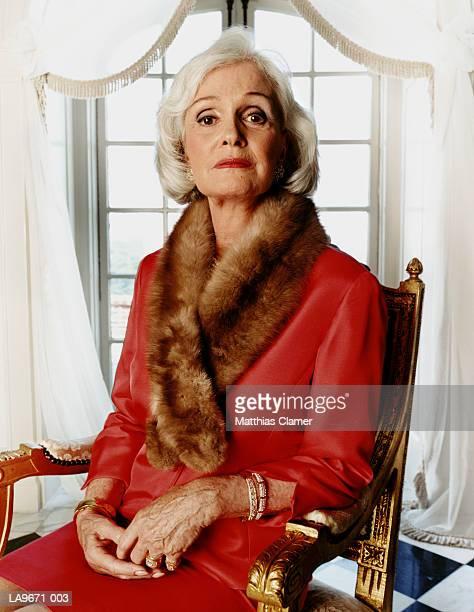 Mature woman wearing fur wrap, portrait