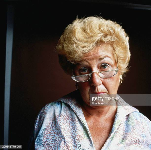 mature woman wearing glasses, close-up, portrait - headhunters stock pictures, royalty-free photos & images