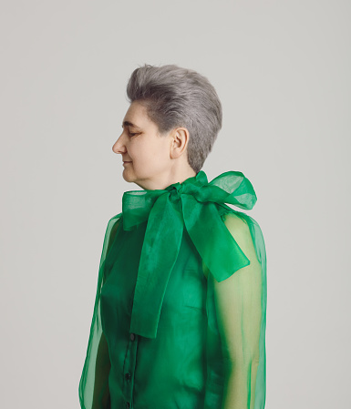 Mature woman wearing green blouse - gettyimageskorea