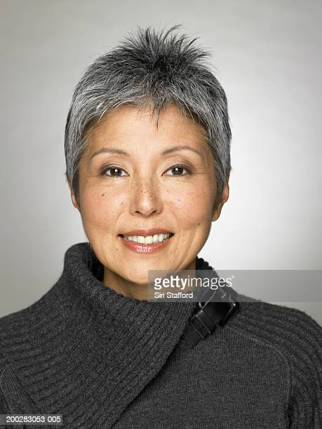 Mature woman wearing grey top, portrait