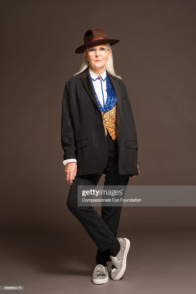 Mature woman wearing hat and stylish clothes : Stock Photo