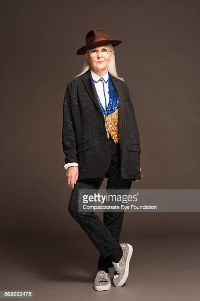 Mature woman wearing hat and stylish clothes