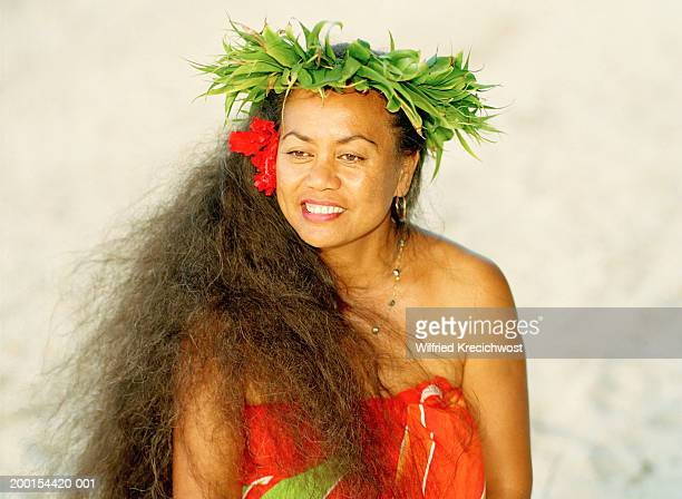 mature woman wearing head wreath and sarong, outdoors, close-up - headwear stock pictures, royalty-free photos & images