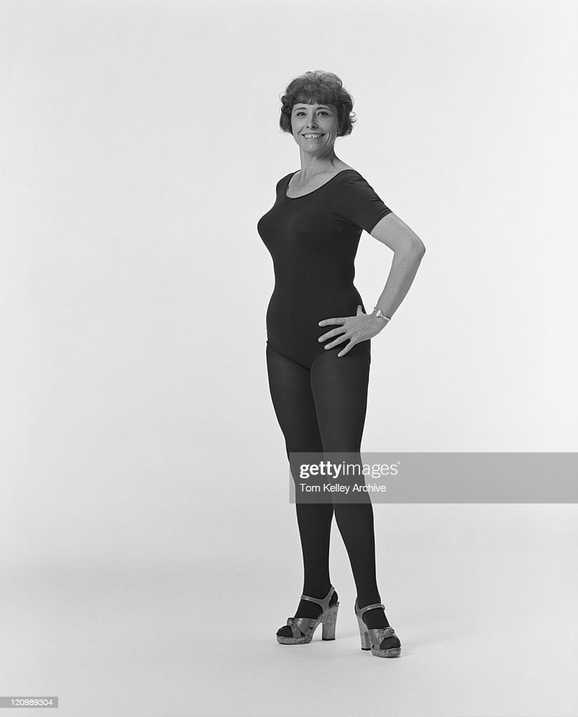 mature woman wearing leotard smiling portrait stock photo | getty images