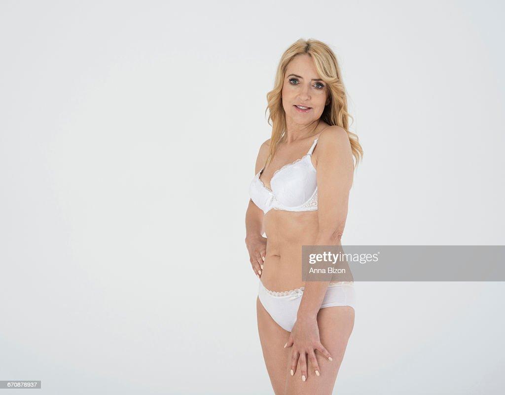 mature woman wearing lingerie in the studio debica poland stock