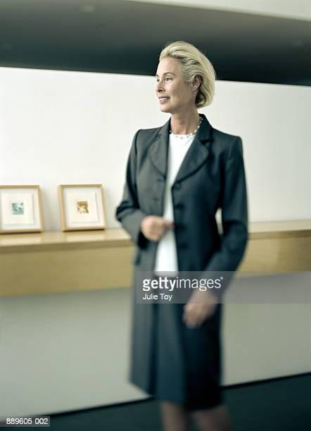 Mature woman wearing long coat, profile