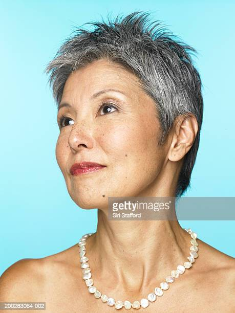 Mature woman wearing pearl necklace