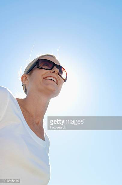 Mature woman wearing sunglasses (low angle view)