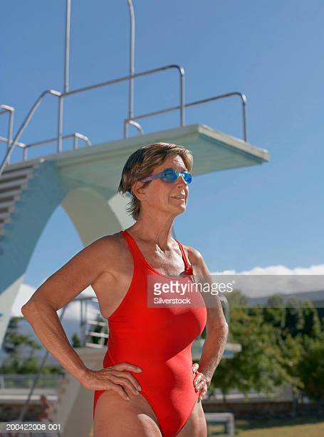mature woman wearing swimsuit and swimming goggles outdoors - one piece swimsuit stock pictures, royalty-free photos & images