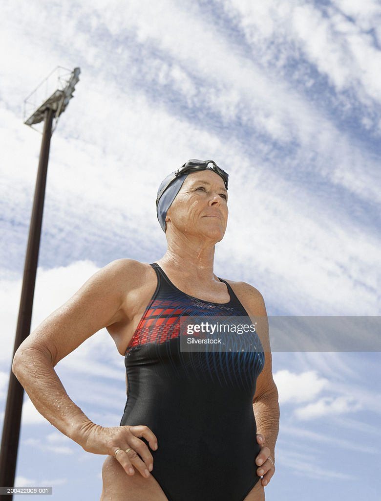 Mature Woman Wearing Swimsuit Outdoors Low Angle View Stock Photo - Getty Images-2131
