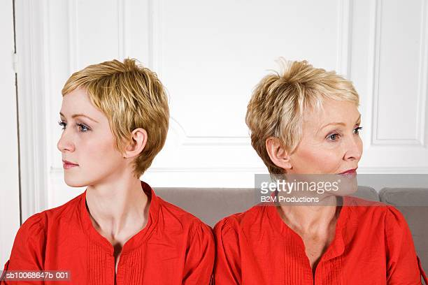 Mature woman with adult daughter looking in opposite directions