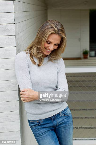 Mature woman with arms folded, smiling