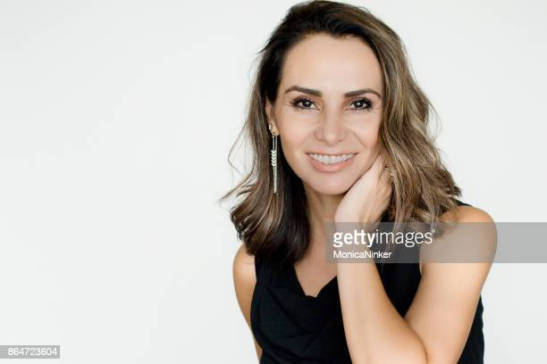mature woman with braces - orthodontics stock photos and pictures