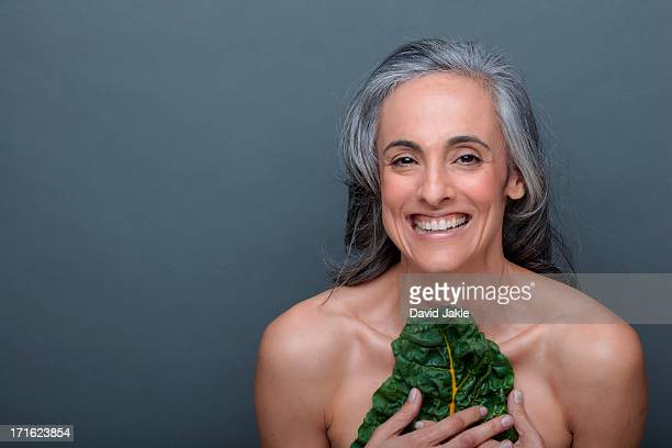 Mature woman with chard