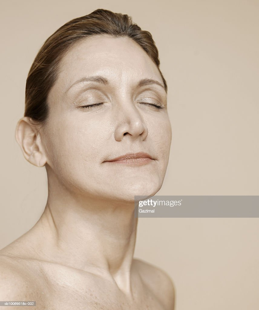 Mature Woman With Eyes Closed Closeup High-Res Stock Photo