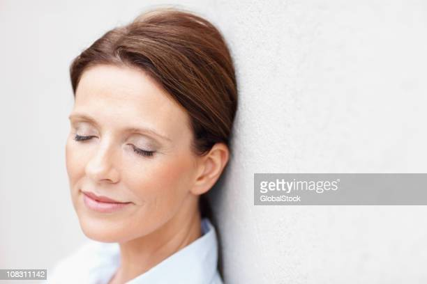 mature woman with eyes closed - eyes closed stock photos and pictures