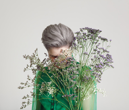 Mature woman with flowers - gettyimageskorea