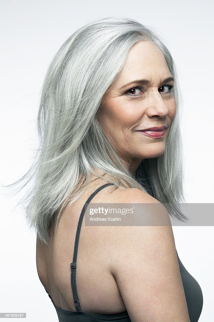 Mature woman with grey hair in a 3/4 position. : Stock Photo