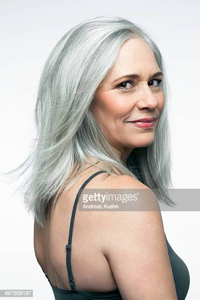 Mature woman with grey hair in a 3/4 position.