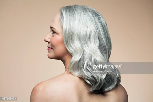 Mature woman with grey hair, rear view profile.