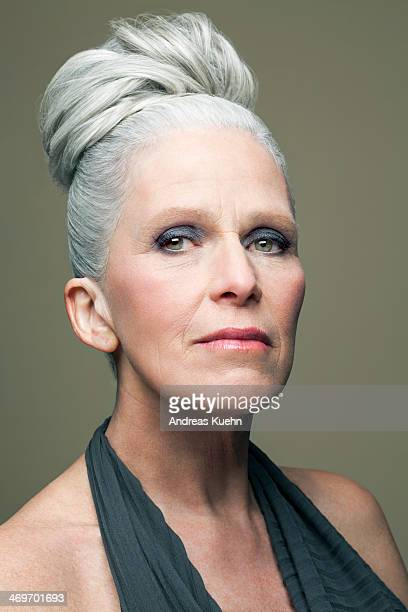 Mature woman with grey haired bun, portrait.