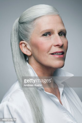 Mature Woman With Grey Haired Ponytail Portrait High-Res