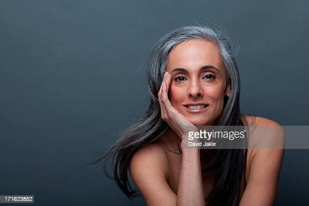 Mature woman with hand on chin