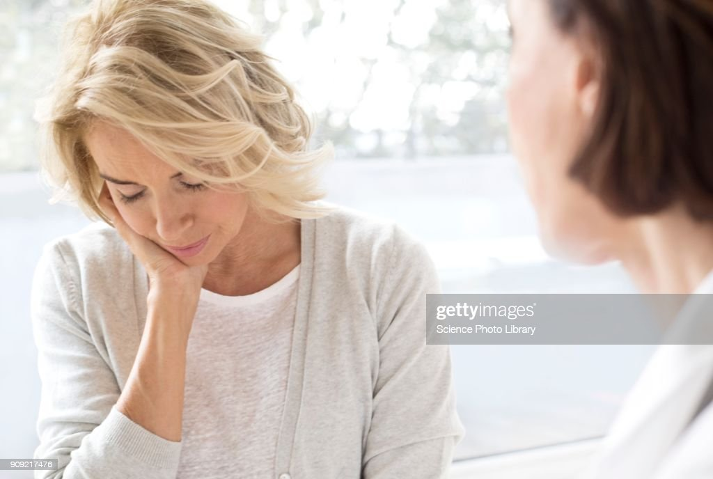 Mature woman with hand on chin : Stock Photo